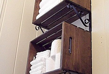 Crate wall storage: stained wooden crates from Michael's, home improvement store brackets,.