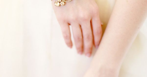 a gilded beauty of a bracelet worn by the Bride Photography by