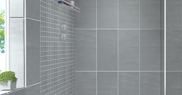 Create a modern looking bathroom by mixing different shapes of floor tiles,