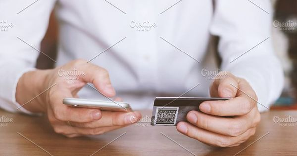 Woman hands holding credit card and using smart phone for online shopping