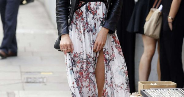 Stella Maxwell dressed down a floral chiffon maxi dress by pairing it