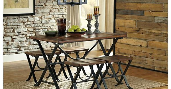 Medium Brown Freimore Dining Room Table And Stools Is