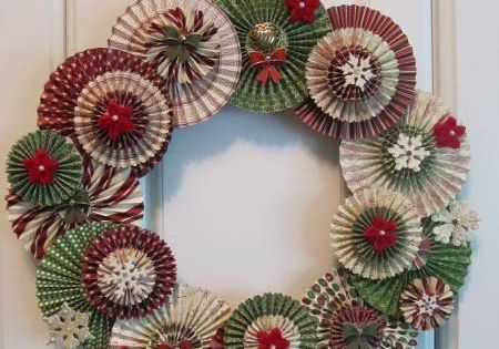 Great idea--a wreath made from paper rosettes! Use a scoring board (or