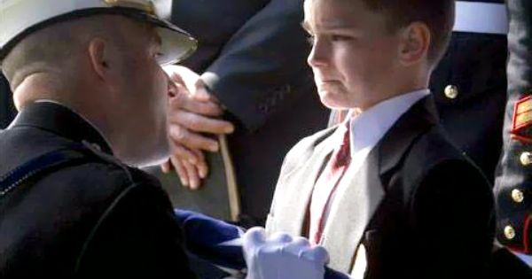 This photo just breaks my heart. Eight-year-old Christian Golczynski accepts the flag