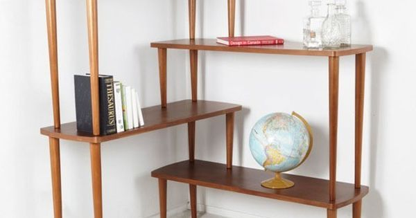 corner shelving unit in living room. find coffee tables at thrift store.