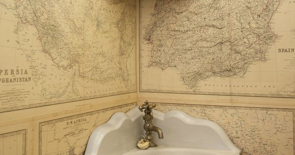 Mr. Brennan decorated the first-floor powder room with pages from another book,