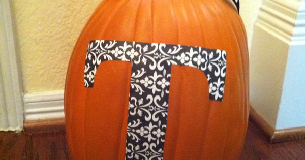 Initial pumpkin. Enlarged the letter and traced onto scrapbook paper. Mod Podge