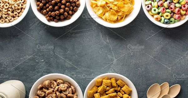 Variety of cold cereals in white bowls, quick breakfast for kids overhead shot with copyspace (Cheerios inspired)