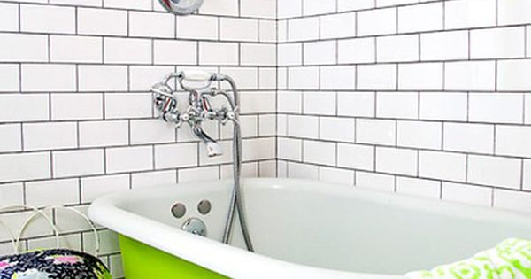 More white subway tile dark grout combo love it for Bright green bathroom ideas