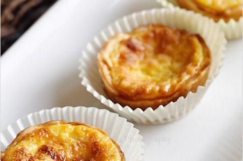 LOVE these :D Portuguese Egg Tarts Recipe - pie crust, eggs, sugar,
