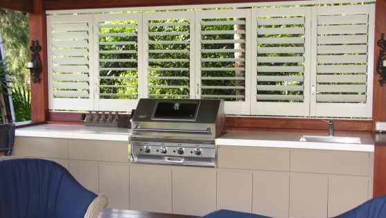 Nice bbq and outdoor kitchen area enclosed by white for Kitchens western sydney