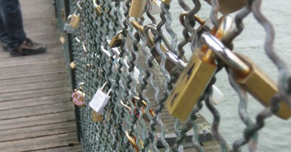 "This is a ""Love Lock Bridge"" in Paris. You hang locks on"