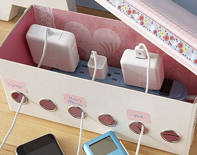 Charging station from a shoebox and power strip : cute idea, keeps
