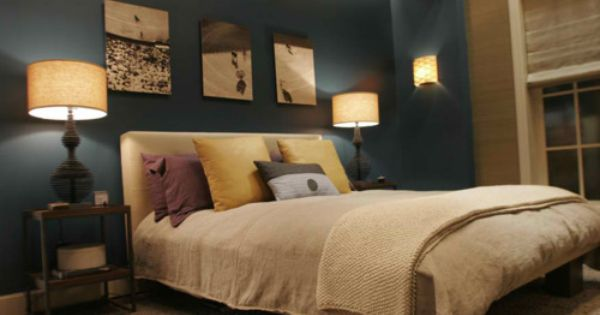 lamps on nightstands on both sides blue sand color scheme