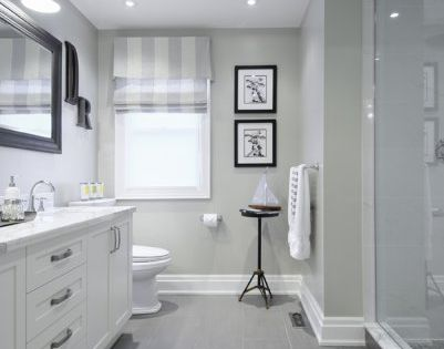 Gray tile floor with white vanity... Bathroom ideas/ love how they have the tiles that looks like the runner carpet. *GRAY FLOOR LIKE OURS