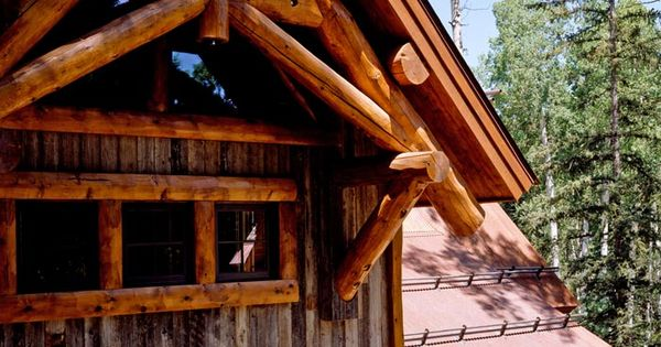The master bedroom gable showcases a structural log - Exterior structural wood brackets ...