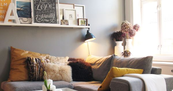 Love the grey wall, Also Photo shelves are a great idea for