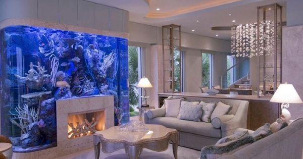 Exquisite luxury home interior fireplace fish aquarium for Fish tank fireplace