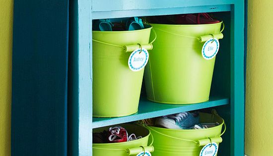 Organize the entry way with a shelf and buckets for each person.