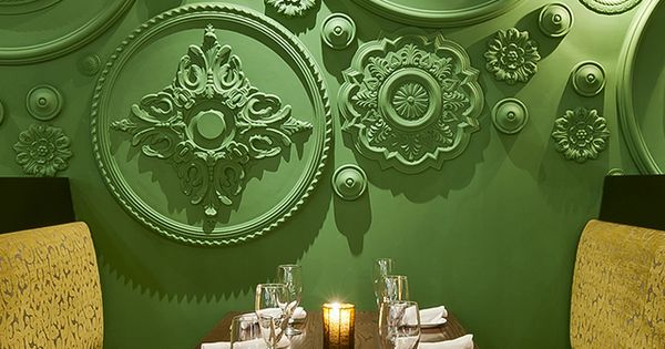 Ceiling Roses as wall treatment. Cool idea. Barbatella Restaurant in Naples Florida