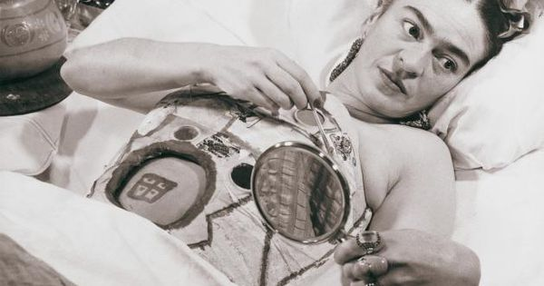 Frida Kahlo,painting on her body cast, after one of her ...