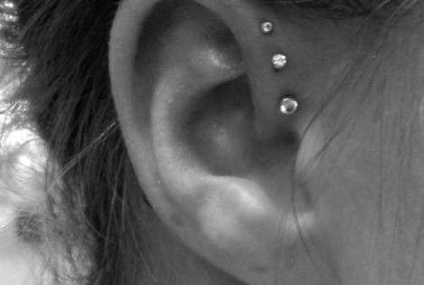 I've always love ear piercings. Haven't seen this variation before - love