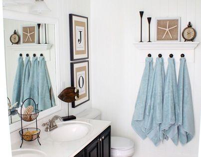 DIY Coastal bathroom Love the white walls, blue ceiling, black vanity &