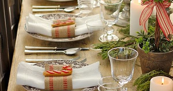 Trees, greenery and burlap napkin rings create a simple, Christmas table setting.