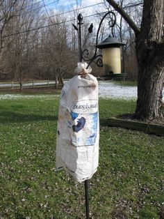 The Most Effective Squirrel Baffle Ever And It Came Free With Your Birdseed Homemade Bird Feeders Squirrel Baffle Squirrel Proof Bird Feeders