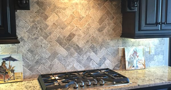 travertine subway tile with herringbone pattern for