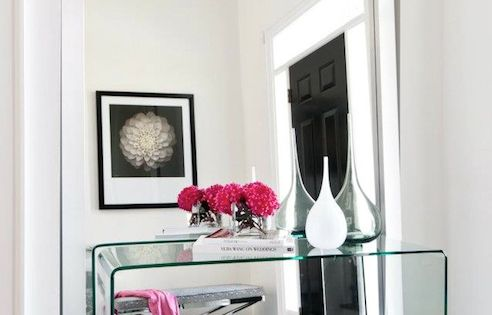 Foyer Leaning Mirror : Lucite glass waterfall console paired with a leaning wall