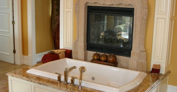 A delicious tub in front of a fireplace in a grand master for Beautiful master bedrooms and bathrooms