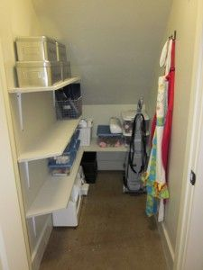 Shelves Under Stairs And Wrapping Storage On Back Of Door For