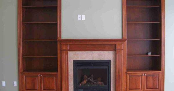 Custom fireplace with built in bookshelves cedar ridge for Cedar ridge storage