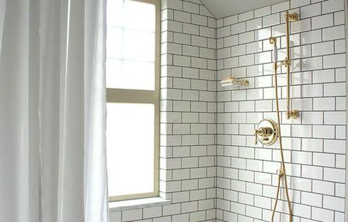 Bathroom - white subway tile, white vintage hex tile, dark grout, brass