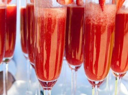 Strawberry Mimosas - 1/3 strawberry puree and 2/3 champagne…much better than orange