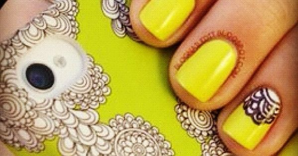 Yellow nails. Also love the phone cover :)