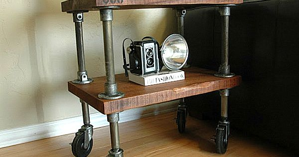 Thick wood shelves with aged iron pipe on casters. DIY END TABLE