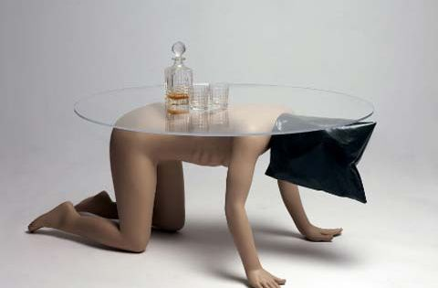 A serious conversation pieace abu ghraib coffee table by for Bizarre coffee table