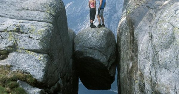 Kjeragbolten boulder, Norway. Bout to have a anxiety attack just looking!!