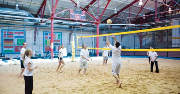 The Sports Center At Chelsea Piers Indoor Sand Volleyball Court Is Open For Pick Up Games Private Instructio Indoor Beach Sand Volleyball Court Sports Complex