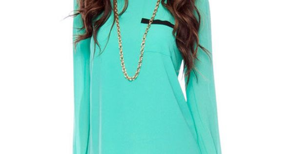 neon teal top with leather shorts =