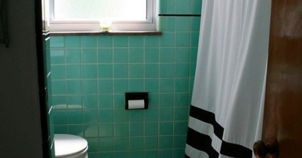 Seafoam Green And Black Trimmed Tile Walls With A Black