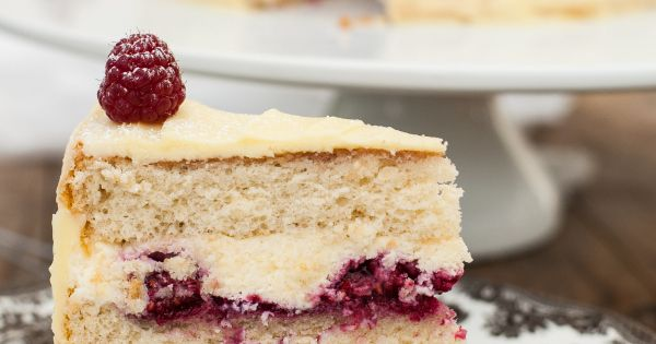 Delicate vanilla cake layers filled with mascarpone cream and raspberry compote and