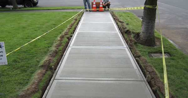 How to pour a concrete sidewalk sidewalk concrete and yards for Pouring your own concrete driveway