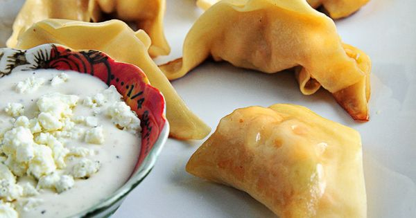 Buffalo Chicken Potstickers... with a blue cheese & Greek yogurt sauce... Blue