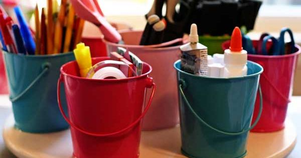DIY lazy Susan. GREAT idea for the kid's art supplies.