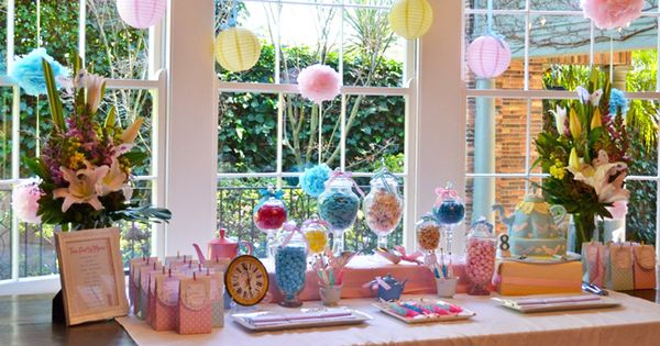 Fun treat table for a sweet shop birthday party. Fun hanging lanterns