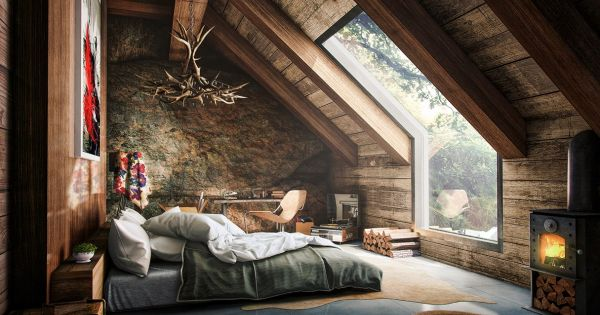 An attic bedroom that opens up into the forest is like a