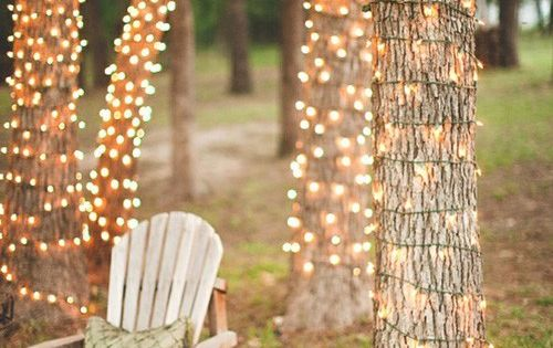Outdoor party lighting idea - wrap the bases of your trees with
